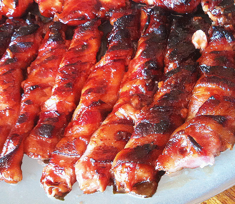 Sweet and spicy bacon wrapped pork strips